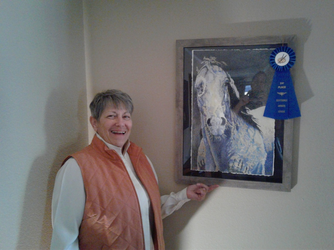 "Marsha LAZAR Klinger with her color pencil art ""Blue War Horse"""