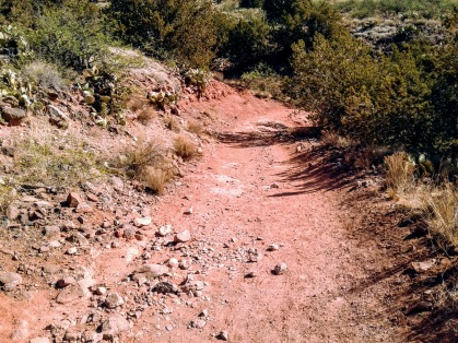 Hiking trail composed of red dirt and loose rocks