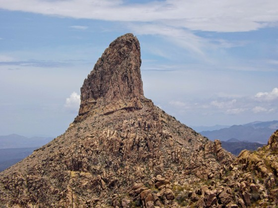 Weavers Needle rock formation rises above surrounding landscape