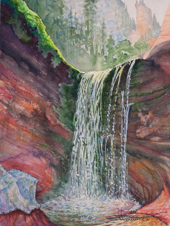 Image of water falling over red rocks
