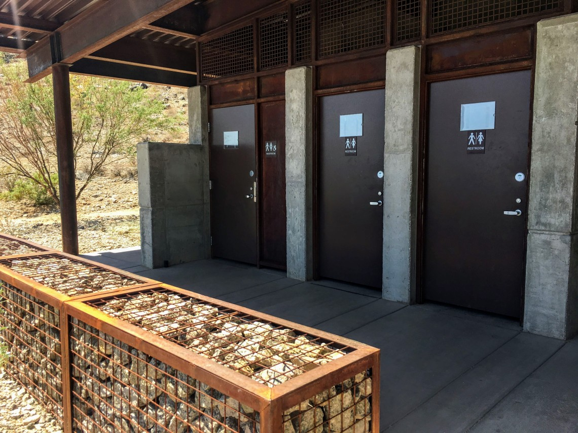 View of three restroom doors with unisex insignia