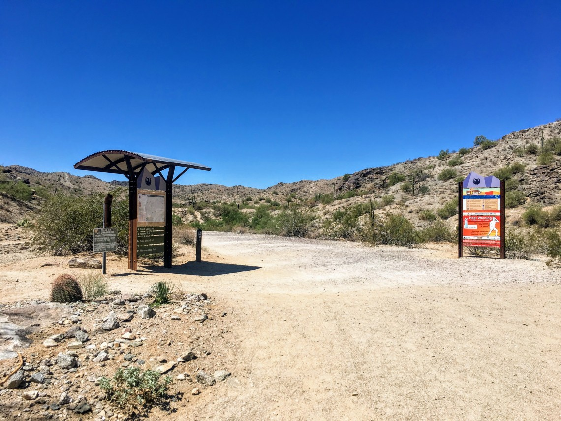 Hiking trailhead with signs on either side