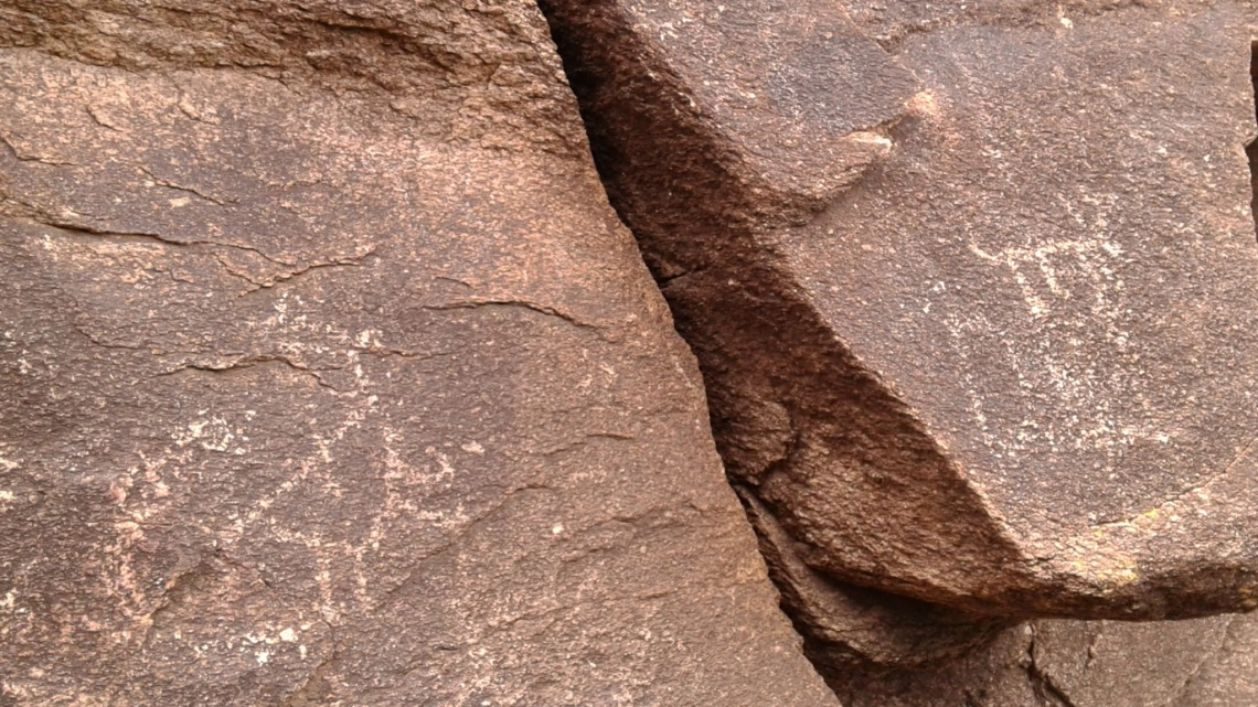 Images carved into rock face