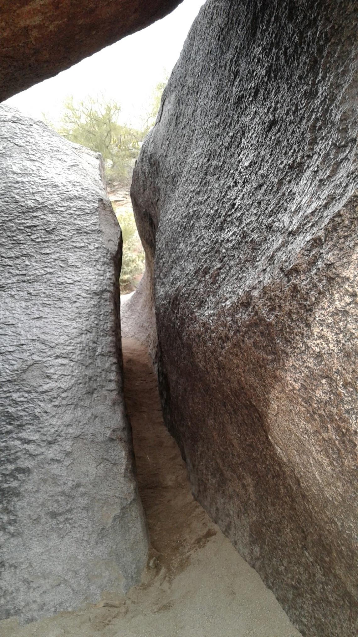 Narrow slit between two boulders